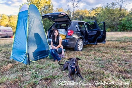 Sharon and her dog camping in her car at Sleepy Creek HarFest.Mama Corn