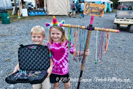 At Sleepy Creek two children selling jewelry they made.Mama Corn