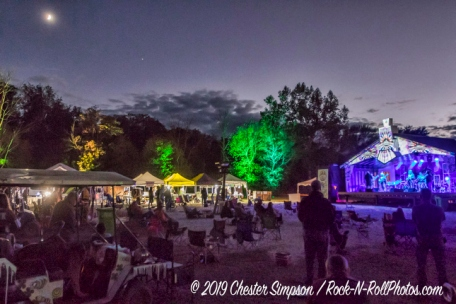 Sleepy Creek stage and area at night with a crescent moon above.Mama Corn