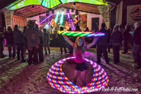 Grant Farm with little girl hula hooping near stage.Mama Corn